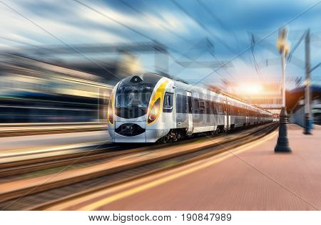 High Speed Train In Motion At The Railway Station At Sunset
