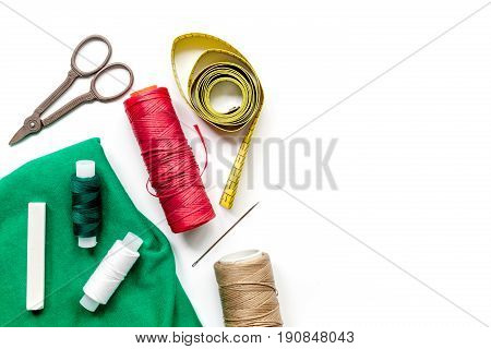 tailor workspace with sewing and handmade tools on white desk background top view mock up