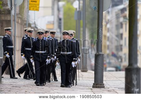 HELSINKI, FINLAND - MAY 25, 2015: The state funeral of the former President of the Republic of Finland Mauno Koivisto. Military cadets parading before funeral service of the late Finnish President Mauno Koivisto May 25, 2017 in Helsinki, Finland.