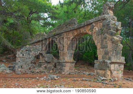 Stone aqueduct in the ancient city of Phaselis. Ancient Phaselis ruins in Turkey Kemer Antalya