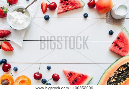 Summer Fruits. Fresh Juicy Berries, Watermelon And Papaya On The White Wooden Table, Top View