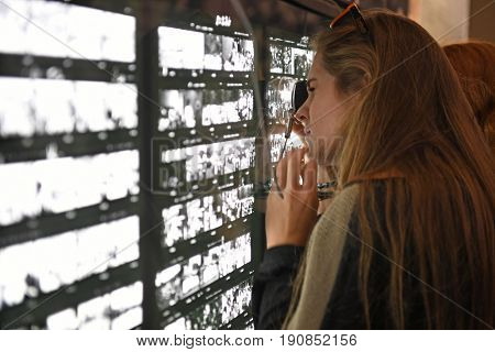 Memphis, TN, USA - June 9, 2017: Young woman viewing exibit at the National Civil Rights Museum and the site of the Assassination of Dr. Martin Luther King Jr.