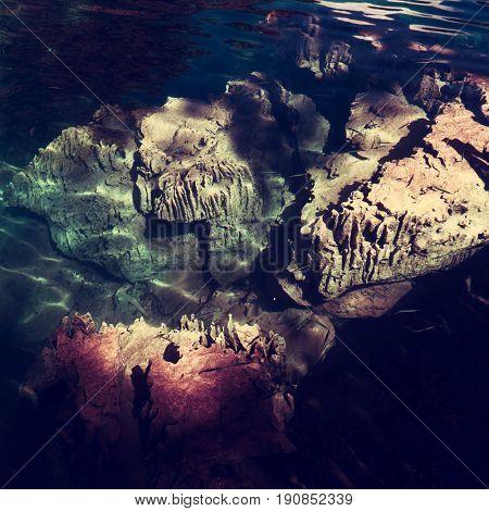 Clear water, rocks and fish in Kayangan Lake. Coron. Palawan