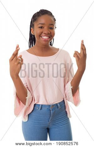 Happy african girl with her fingers crossed isolated on white background