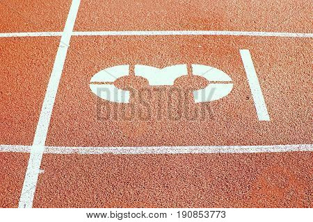Number Three. White Track Number On Red Rubber Racetrack, Texture Of Running Racetracks In Small Sta