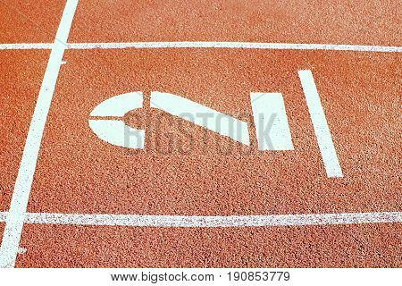 Number Two. Big White Track Number On Red Rubber Racetrack. Gentle Textured Running Racetracks In Ou