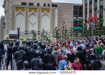12 June 2017. Russia. Moscow. Tverskaya st. Meeting organized by Alexei Navalny against corruption in  government. Heavy armored police forces and crowd of people at metro exit.