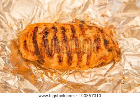 fried chicken grilled breast stake on a foil
