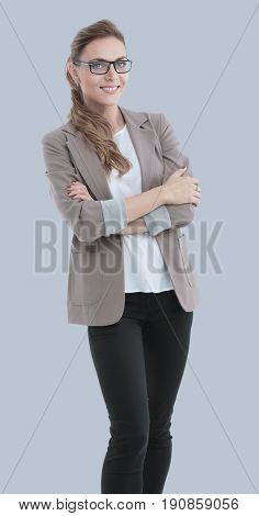 Beautiful smiling business woman isolated gray background.