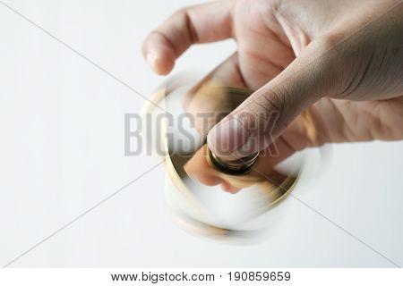Isolated Hand Spinning Goldren Metal Fidget Spinner