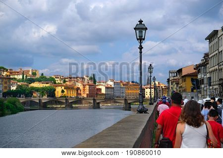 Florence, Italy - June, 5, 2017: embankment of Arno river in Florence, Italy