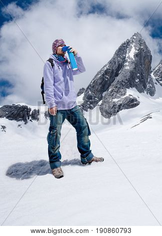 Climber breathing with mini portable oxygen cylinger to avoid and treat Altitude Sickness synptom poster