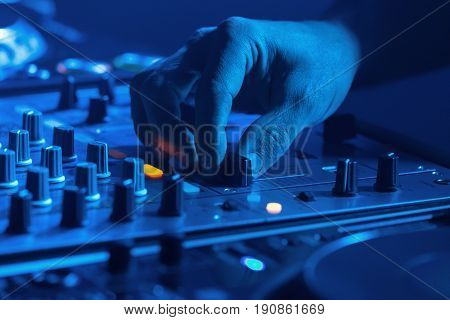 Dj Mixing Music With Blue Light