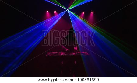 Disc Jockey, Dj, Silhouette On Laser Beams