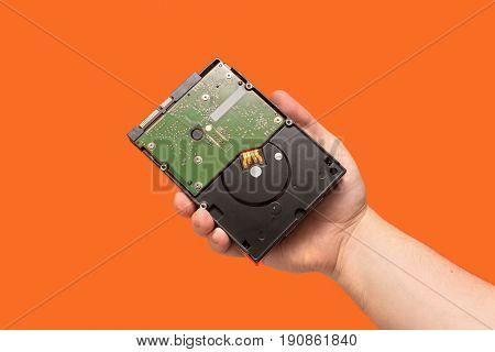 Hdd Hard Disk Drive On Orange Background