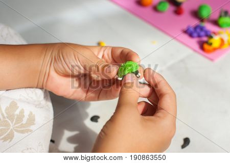 Child Hands With Plasticine In Home At Thailand.