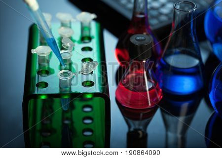 Scientist filling test tube science lab