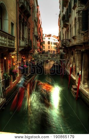 Motion blur activity on a canal in Venice, Italy.