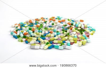 Heap of various drug pills capsules and tablets. Colorful pharmaceutical drugs tablets and pills and capsules over white background. 3d illustration