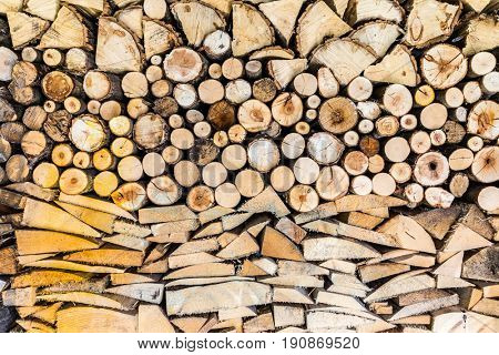 Pile of wood logs ready for winter in the garden