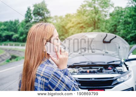 Young Woman Calling For Assistance With His Car Broken Down By The Roadside