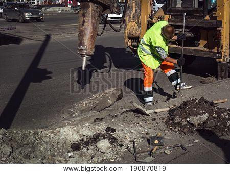 Worker Repairing A Road Hammer Crowbar