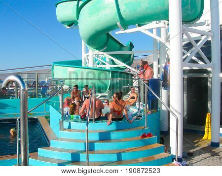 Miami, United States of America - January 12, 2014: The people resting at jacuzzi at Carnival Glory Cruise Ship, the ship leaving Miami, USA on January 12, 2014. Carnival Glory is a Conquest-class cruise ship built in 2003 with capacity of 2974 passengers