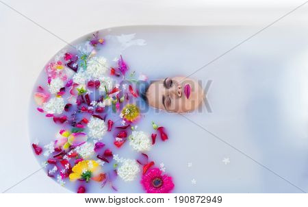 Closeup view of Woman in bath. Her face is drowning in a gentle bath.