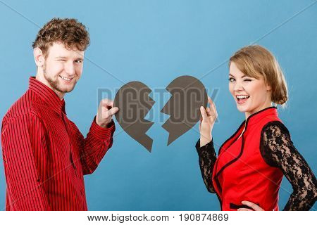 Smiling Couple Fixing Heart.