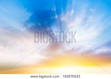 beautiful cloudy blue sky morning sun rise with sunny bright shining golden light ray from dark cloud new years background or heaven gate opening concept.