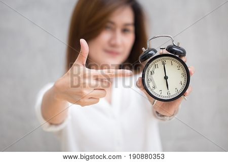 Asian Women Hand And Point Finger To Retro Clock Times At 6 O'clock, It's Time To Do Something Conce