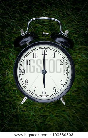 Closeup Times Retro Clock Lay On Green Grass Nature Face Timed At 6 O'clock Dark Night Time For Back