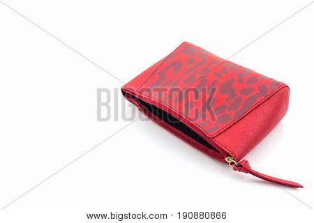 Red leather cosmetic bag on white background.