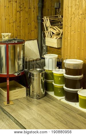 buckets full of extracted honey out of a centrifuge and other Beekeeper equipment