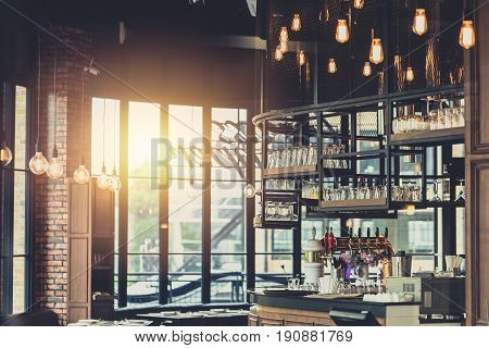 Modern Loft Style Restaurant Decoration With Hanging Light Bulb Beer Pub And Bar.