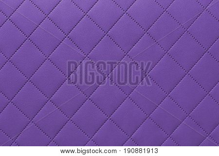 detail of sewn leather purple leather upholstery background pattern