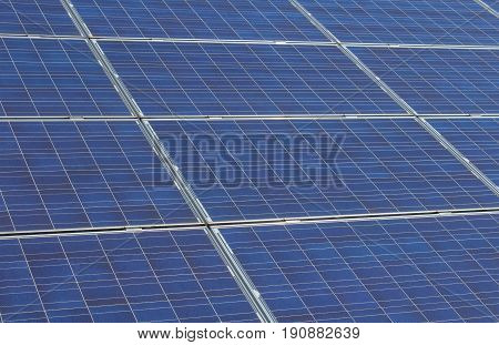 Detailed photo to photovoltaic solar panels in metal frame