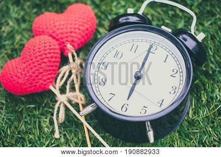 Retro Clock On Grass Time At 6 O'clock With Red Heart Yarn Wool, Sweet Love Memory Times Concept.