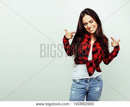 young happy smiling latin american teenage girl emotional posing on white background, lifestyle people concept close up