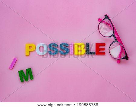 cut the word impossible to possible. Alphabet I M being cut. Change concept.