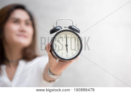 Asian Women Hand Retro Clock Times At 6 O'clock, It's Time To Do Something Concept.