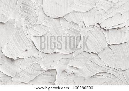 White decorative abstract plaster texture with textured smears.