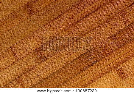 Bamboo brown wood texture tilt plank top view closeup.
