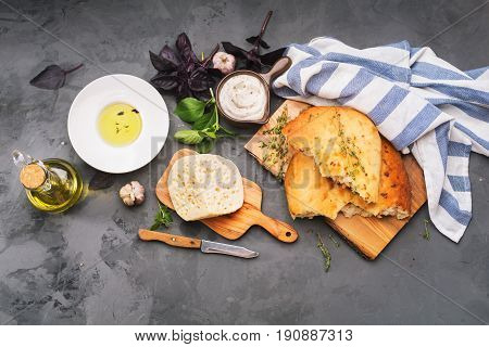 Traditional Italian Focaccia with herbs and cheese. Top view