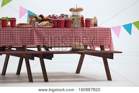 Wood Table And Red Napkin Cover For Outdoor Party