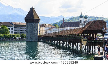 Luzern Switzerland - May 27 2017: View at the Chapel bridge over Reuss river in Luzern (Lucerne) Switzerland.