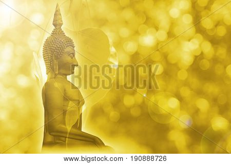 Golden Buddha with bodhi leaf grow in blur gold background for postcard design.