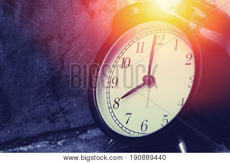 8 O'clock Vintage Clock At Dark Color Tone With Sun Light Memory Time Concept.