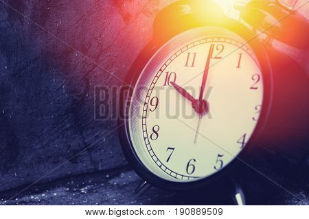 10 O'clock Vintage Clock At Dark Color Tone With Sun Light Memory Time Concept.