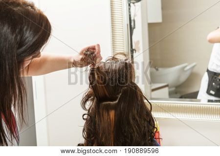 Woman Getting Her Hairstyle Done At Hairdresser